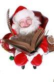在书的圣诞老人文字 免版税库存照片