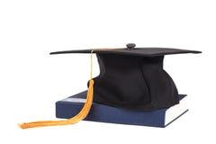 在书的毕业盖帽 库存图片
