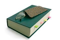 在书的玻璃 免版税图库摄影