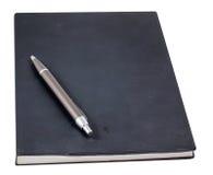在书的笔 免版税库存图片