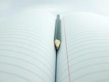 在书的铅笔 免版税图库摄影