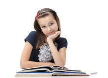 在书的兴高采烈的女小学生 库存照片