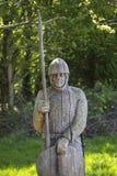 在争斗修道院的11世纪战士雕塑 免版税库存照片