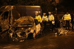 在事故的被烧的汽车 免版税库存图片