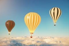 在云彩上的三个气球在日落 免版税库存照片