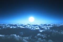 在云彩上的夜间飞行 库存图片