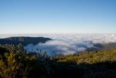 在云彩上的日落 库存图片