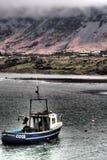 在云彩下的渔船 免版税库存图片