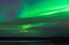 在云彩之后的北极光 免版税库存照片