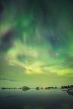 在云彩后的极光 免版税图库摄影