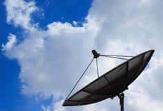 在云彩和天空背景的卫星盘  免版税库存图片