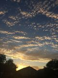 在云彩日落之后 免版税库存照片