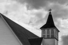 在云彩的古色古香的教会尖顶 免版税库存照片