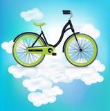 在云彩的唯一bycicle骑马 图库摄影
