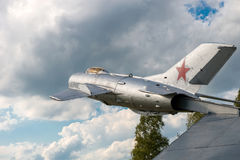 在云彩的战斗机 图库摄影