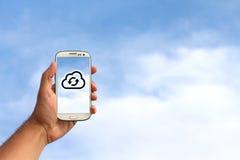 在云彩的手机 免版税库存照片