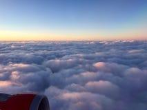 在云彩的早晨太阳 免版税库存照片