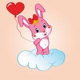 在云彩的桃红色兔宝宝 免版税库存照片