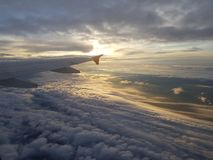 在云彩的航空器 库存图片