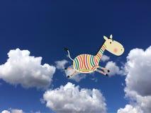 在云彩的色的斑马 库存图片