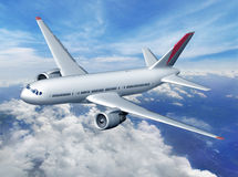 在云彩的飞机 免版税库存图片