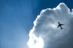 在云彩的飞机 免版税图库摄影