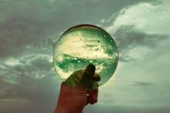 在云彩背景的绿色苏联透镜 免版税库存照片