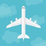 在云彩附近的传染媒介飞机顶视图 图库摄影