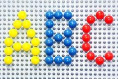 在五颜六色的塑料针的ABC 免版税库存图片