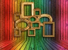 在五颜六色的木墙壁的古色古香的框架 库存照片
