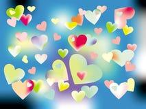 在五颜六色的背景的五颜六色的心脏 免版税库存照片