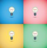 在五颜六色的背景的电灯泡想法 免版税库存图片