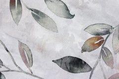 在亚麻制桌布的叶子设计 免版税库存图片
