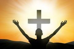 在交叉的基督徒崇拜 库存图片