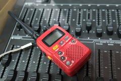 在交换机控制器的一个红色携带无线电话 库存照片