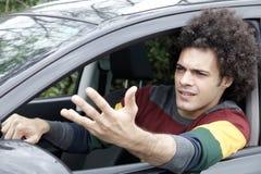 在交通恼怒的驾驶的汽车困住的人 免版税库存图片