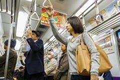 在京都地铁的Commouters 库存图片