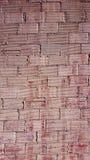 在人字形样式的西班牙砖墙 库存图片