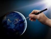 在人的事物的上帝的干预地球上。 免版税库存照片