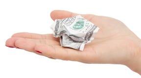 在他的在白色背景的手上弄皱的100美元 免版税库存照片