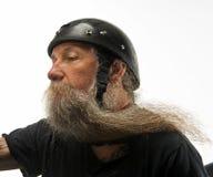在他的胡子的风 免版税图库摄影