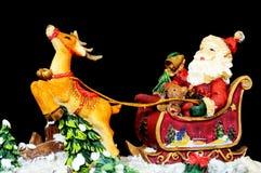 在他的雪橇的父亲圣诞节 免版税库存图片