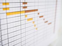 在企业时间表办公室生活方式上的日程 库存图片