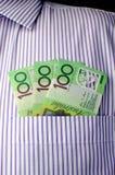 在企业衬衣口袋的三百美元笔记-垂直。 免版税库存图片
