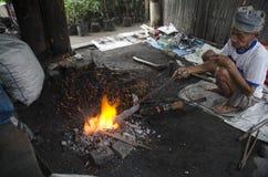 在传统市场上的铁匠 免版税库存图片