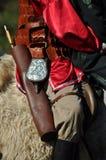 在传统服装的骑马示范 库存照片
