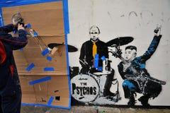 在伦敦,英国街道上的著名街道画工作  免版税库存照片