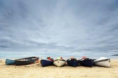 在伯恩茅斯海滩的渔船 库存图片
