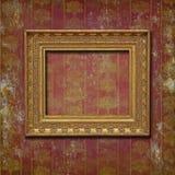 在伯根地酒grunge墙纸的金黄框架 免版税图库摄影