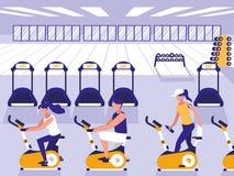 在体育健身房的人乘坐的转动的自行车 皇族释放例证